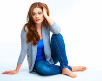 Casual style young woman with long hair  posing on white floor. Stock Photos