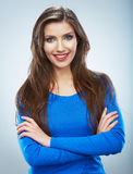 Casual style young woman posing on isolated studio background. Royalty Free Stock Photography