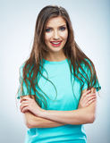 Casual style young woman posing on isolated studio background. royalty free stock image