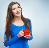 Casual style young woman posing on isolated studio background. Royalty Free Stock Photo