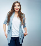 Casual style young woman posing on  studio backgro Stock Photography