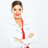 Casual style young woman posing on  studio backgro Stock Photos