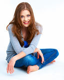 Casual style young woman posing on white floor. Royalty Free Stock Image