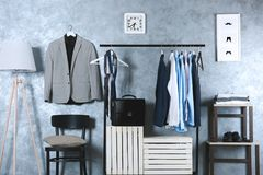 Casual stylish male clothes on hanger stand. In room Royalty Free Stock Photography