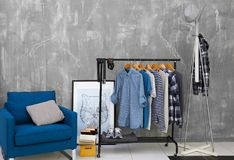 Casual stylish male shirts on hanger stand. In room Stock Photo