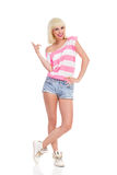 Casual summer blonde girl pointing Stock Photo