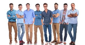 Casual team of eight men with a senior member royalty free stock image