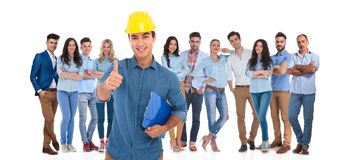 Casual team with engineer leader making ok sign in front stock photo
