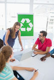 Casual team having meeting about eco policy Stock Photo
