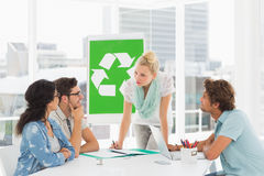 Casual team having meeting about eco policy. In the bright office Royalty Free Stock Photo