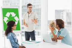 Casual team having meeting about eco policy Stock Photos