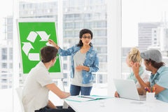 Casual team having meeting about eco policy Royalty Free Stock Image
