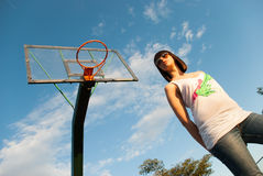 Casual teen on basketball court Royalty Free Stock Images