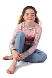 Casual Teen Girl. A full view of a casual, stylishly dressed teenaged girl. Isolated stock photos
