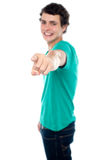 Casual teen guy pointing at you Royalty Free Stock Photography