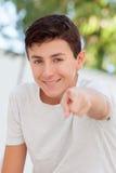 Casual teenager boy indicating at camera Stock Photos
