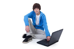 Casual teenager boy sitting on the floor Stock Images