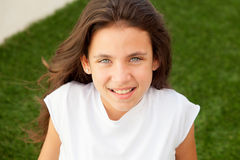 Casual teenager girl sitting on the grass Royalty Free Stock Photos