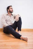 Casual thoughtful man leaning against wall looking up Royalty Free Stock Photography