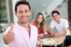 Casual thumbs up Royalty Free Stock Image