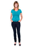 Casual trendy woman with hands in jeans pocket Stock Photography