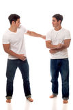 Casual Twins. Casual twin brothers. Studio shot over white Stock Images