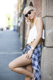 Casual urban young girl talking in the phone Royalty Free Stock Photos