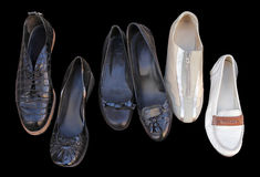 Casual Vintage Women Shoes. Closeup of six different casual vintage women shoes isolated on black background royalty free stock photos