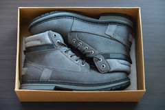 Casual warm boots in a box top view. New fashion grey shoes. Royalty Free Stock Photography