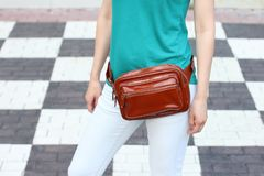 Casual weared women with big leather weist bag on black and whit royalty free stock image