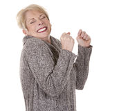 Casual woman. Casual blond woman in her fifties on white isolated background Royalty Free Stock Photography