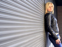 Casual urban woman. A casual woman in an urban environment wearing a leather jacket Royalty Free Stock Photography