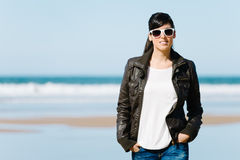 Casual woman on the beach Royalty Free Stock Photo