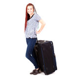 Casual woman with the big travel suitcase Royalty Free Stock Image