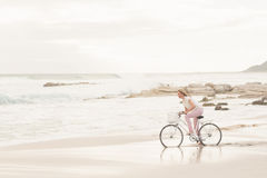 Casual woman on a bike ride Stock Images