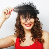 Casual woman with black  feather. Lifestyle Royalty Free Stock Images