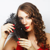 Casual woman with black  feather Stock Photography