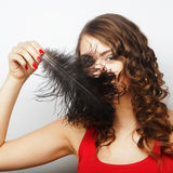 Casual woman with black  feather Stock Images