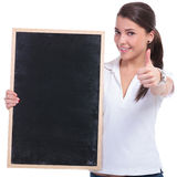 Casual woman with blackboard & ok Royalty Free Stock Photography