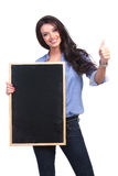 Casual woman with blackboard shows thumb up Royalty Free Stock Photo