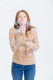 Casual woman blowing soap bubbles Royalty Free Stock Image