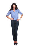 Casual woman with both hands on hips. Full length picture of a young casual woman holding both of her hands on her hips and smiling for the camera. on white Stock Image