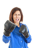 Casual woman celebrating wearing boxing gloves Royalty Free Stock Images