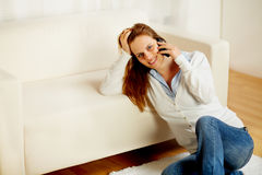 Casual woman on cell phone at home Stock Image