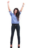 Casual woman cheers with raised hands Royalty Free Stock Image