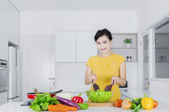 Casual woman cooking vegetables Stock Photos