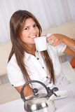Casual woman drinking coffee Royalty Free Stock Image