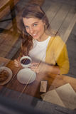Casual woman drinking a coffee Stock Image
