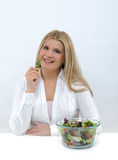 Casual woman eating healthy green vegetable salad Royalty Free Stock Photo