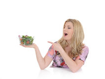 Casual woman eating healthy green vegetable salad Stock Images